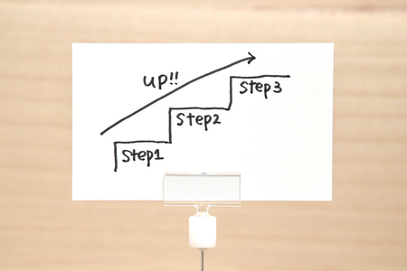 Foto de Handwriting stairs heading upwards with arrow on paper. Business success concept and growth idea. - Imagen libre de derechos