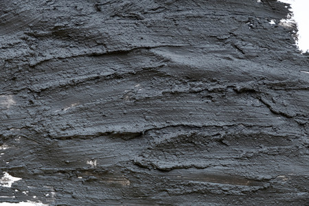 Photo pour Black volcanic cosmetic clay texture close up. solution of cosmetic clay abstract background. - image libre de droit