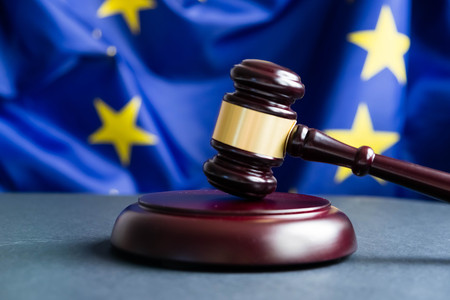 Photo for Judges wooden gavel with EU flag in the background. Symbol for jurisdiction. Wooden gavel on european union flag - Royalty Free Image