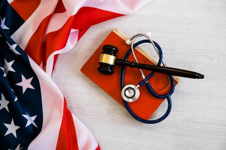 Foto de Gavel and stethoscope on national flag of USA. Forensic medicine concept - Imagen libre de derechos