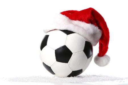 a football ball with christmas cap