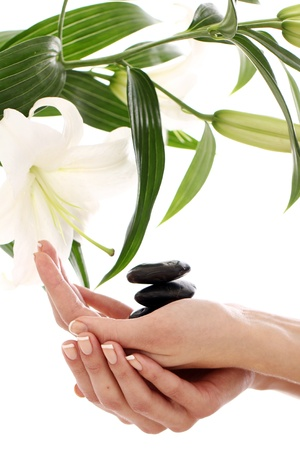Beautiful spa hands over white background