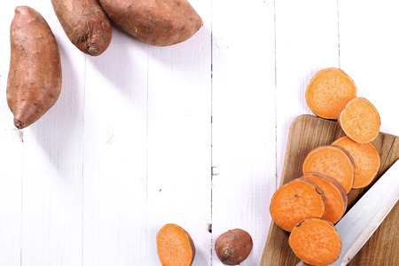 Photo for Sweet potato on the wooden table - Royalty Free Image