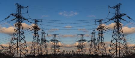 Photo pour Pylon and transmission power line in summer at sunset - image libre de droit