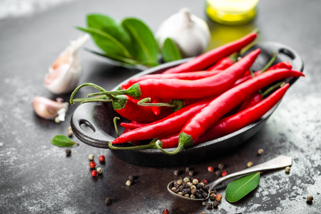 Photo for red hot chili pepper corns and pods on dark old metal culinary background - Royalty Free Image