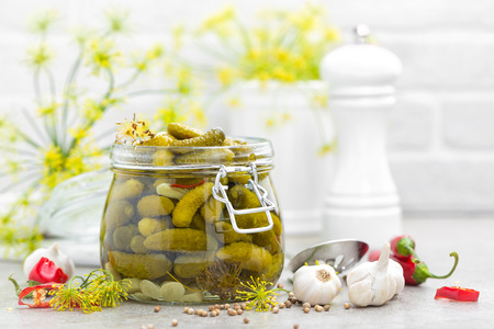 Photo for Pickled cucumbers, small marinated pickles, gherkins - Royalty Free Image