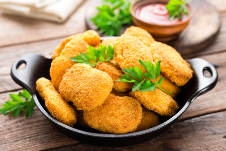 Photo for Nuggets. Chicken nuggets with ketchup on wooden table. Fast food - Royalty Free Image