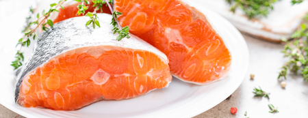 Foto de Fresh raw salmon fish steaks on white kitchen background. Banner - Imagen libre de derechos