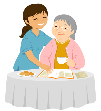 Illustrazione per Young female caregiver smiling to an elderly woman who is placing photos in an album - Immagini Royalty Free