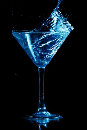 martini splash on black background close up