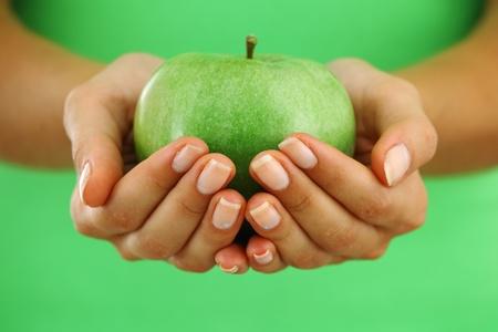 Photo pour apple in woman hands close up - image libre de droit