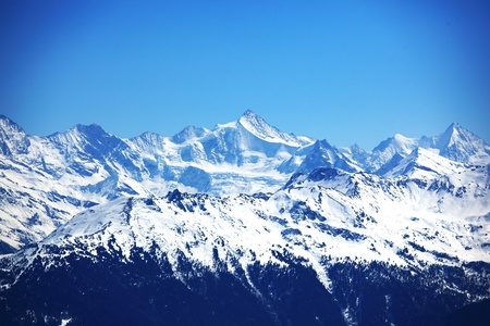 top of mountains in blue sky