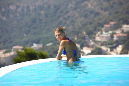 woman portrait in swimming pool