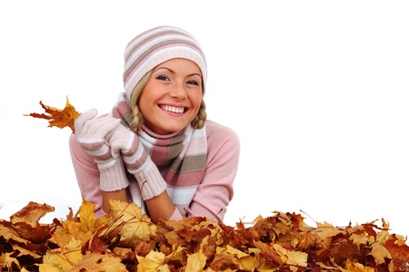 studio portrait of autumn woman in  yellow leaves