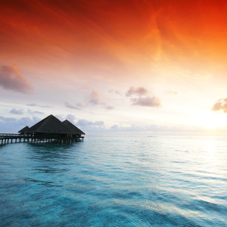 Photo for resort maldivian houses on sunrise - Royalty Free Image