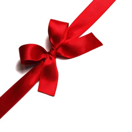 Photo pour Shiny red satin ribbon decorative on white background - image libre de droit