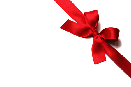 Photo for Shiny red satin ribbon with bow on white background - Royalty Free Image