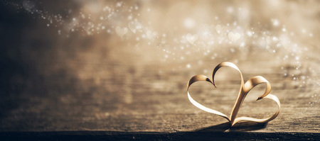 Foto per Two ribbon magic hearts on wooden backround, Valentine day concept - Immagine Royalty Free