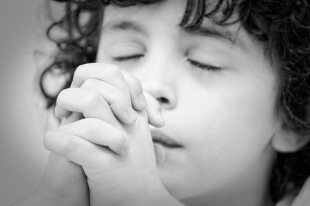 Photo pour A boys talks to his creator with humility and devotion - image libre de droit