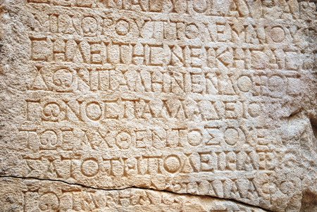 Photo for Ancient Greek writing chiselled on stone - Royalty Free Image