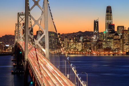 Photo pour San Francisco Bay Bridge and Skyline at dusk. Clear evening over San Francisco waterfront with holiday lights from Yerba Buena Island, California, USA. - image libre de droit