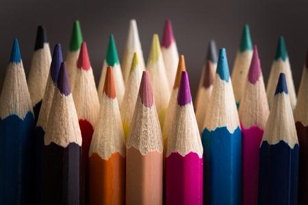 Photo pour Colored pencils closeup on gray background - image libre de droit