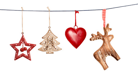 Foto de Vintage Christmas decorations hanging on string isolated on white background - Imagen libre de derechos