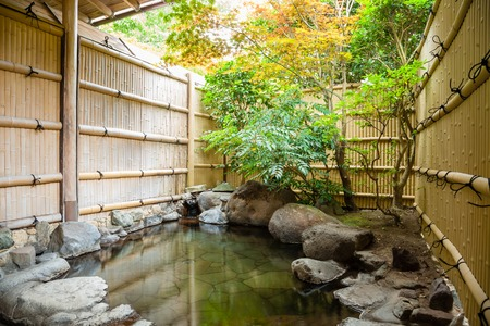 Photo for Outdoor onsen, japanese hot spring with trees - Royalty Free Image