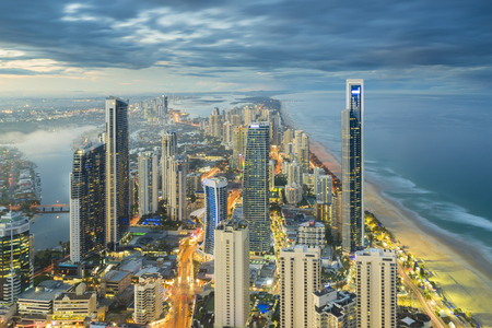 Foto de Aerial view of modern buildings with light trail at riverside at Gold Coast, Australia during sunset - Imagen libre de derechos