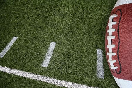 A photo of an American Football field yardage markings with a football on the right border