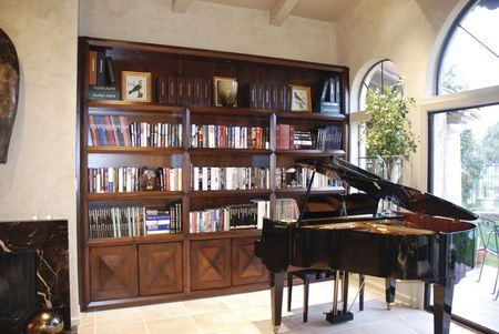 An interior photo of  an Elegant Library and Bookshelves
