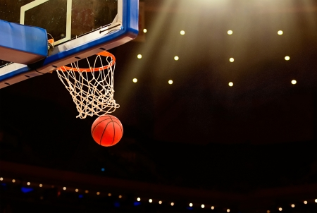 Photo pour Basketball basket with all going through net - image libre de droit