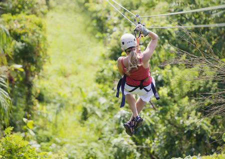 Photo for Woman going on a jungle zipline adventure - Royalty Free Image