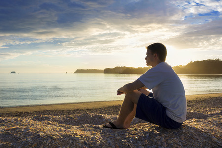 Photo pour Enjoying a sunset at the Beach and meditation - image libre de droit