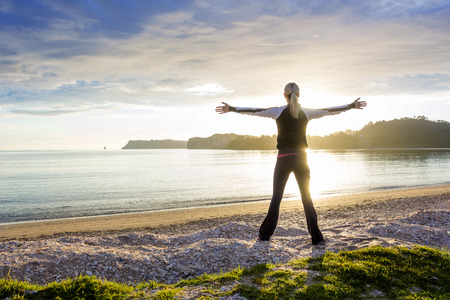 Photo pour Healthy happy woman enjoying a sunny morning on the beach - image libre de droit
