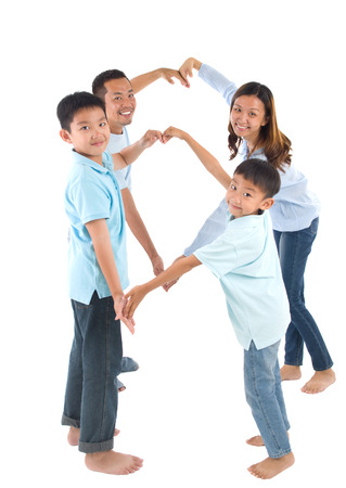 Asian family making heart shape with hands