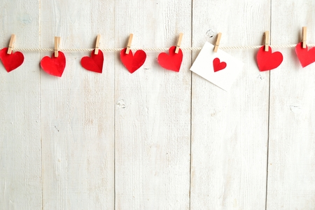 Photo for Red heart message card and red hearts with clothes pins - Royalty Free Image