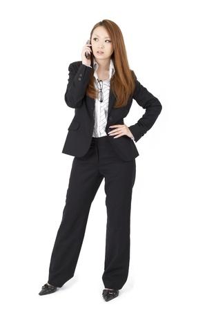 Beautiful asian business woman using a cellular phoen