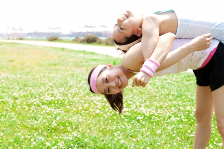 Beautiful young woman doing stretching exercise in the park