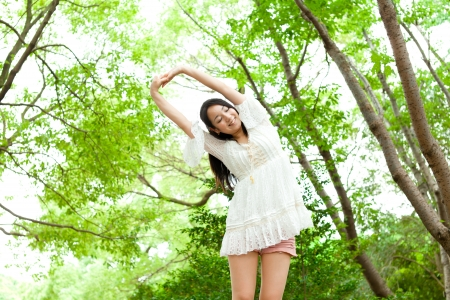 Beautiful young woman in the forest