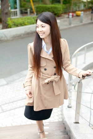 Beautiful business woman in the town
