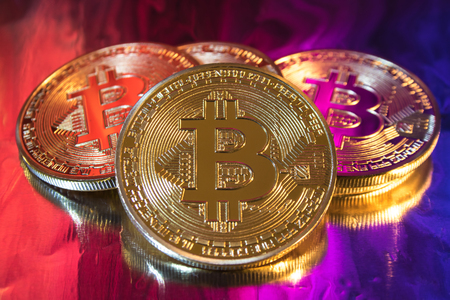 Photo pour Cryptocurrency physical golden bitcoin coin on colorful background - image libre de droit
