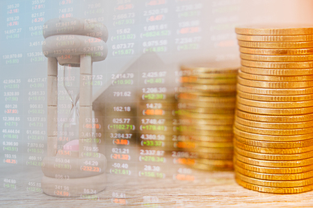 Foto de Concept business and finance. stack of coins and clock hands. idea of time value of money.The present money for time same amount in the future. - Imagen libre de derechos