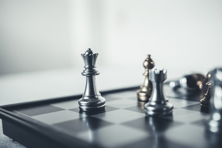 Photo pour Investment Leadership Concept : The king chess piece with chess others nearby go down from floating board game concept of business ideas and competition and strategy plan success meaning. - image libre de droit