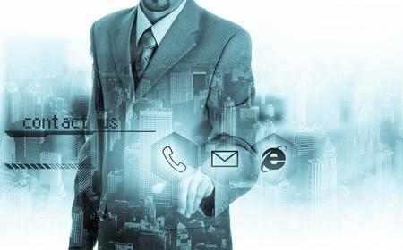 Photo pour Businessman pressing virtual phone buttons. customer support concept. - image libre de droit