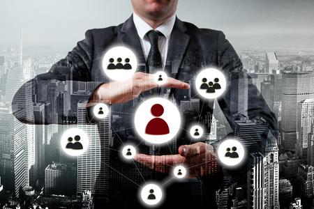 Photo pour Hand carrying businessman icon network - HR,HRM,MLM, teamwork and leadership concept. - image libre de droit