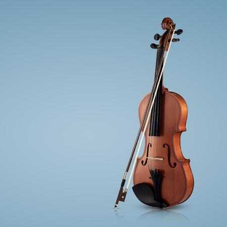 Foto de Violin musical instruments of orchestra closeup on blue background - Imagen libre de derechos
