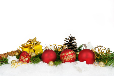 Foto de Christmas lower decoration with balls, stars, cones and gift on white background. - Imagen libre de derechos