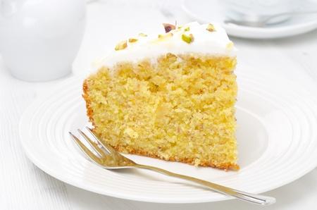 Photo pour piece of orange cake decorated with Greek yogurt, honey and pistachios - image libre de droit