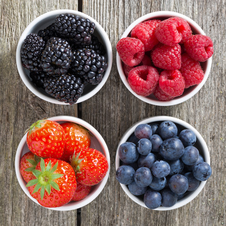 Photo for strawberries, blueberries, blackberries and raspberries in bowls, top view, close-up - Royalty Free Image